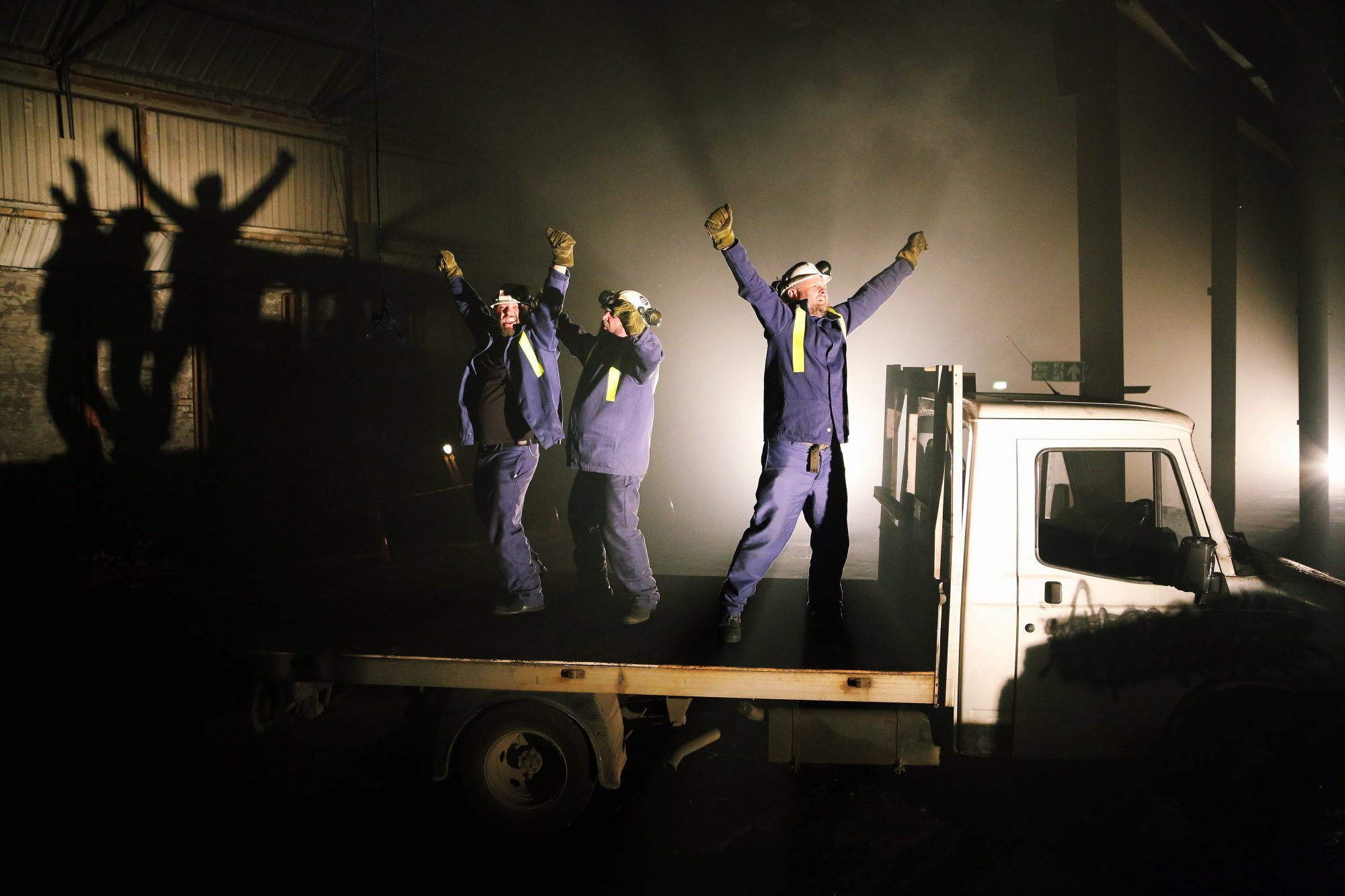 A photograph of We're Still Here, a site-responsive, political promenade theatre piece about the Welsh Steel Industry.