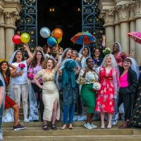 A celebratory photograph of colourful brides from the Wedding Of The Year, a socially engaged piece where women married themselves.