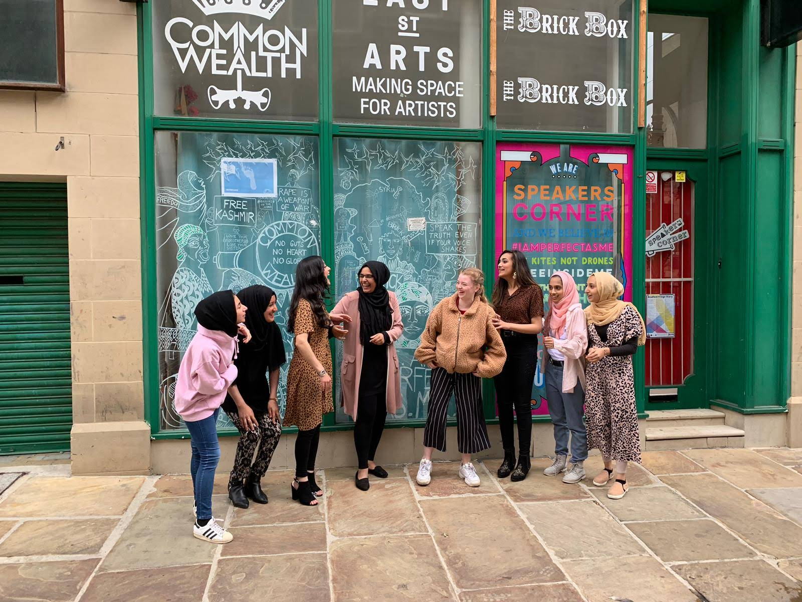 a photograph of the speakers corner women and girls outside the original political social space in Bradford City Centre.