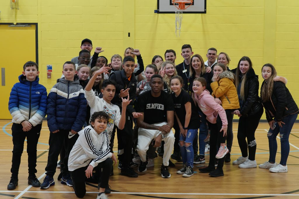 A group photo of around 30 young people and Maxsta