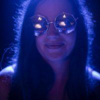 Girl wearing mirrored sunglasses