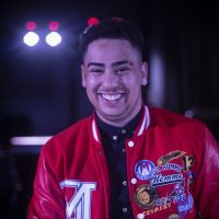 Man in red jacket smiling